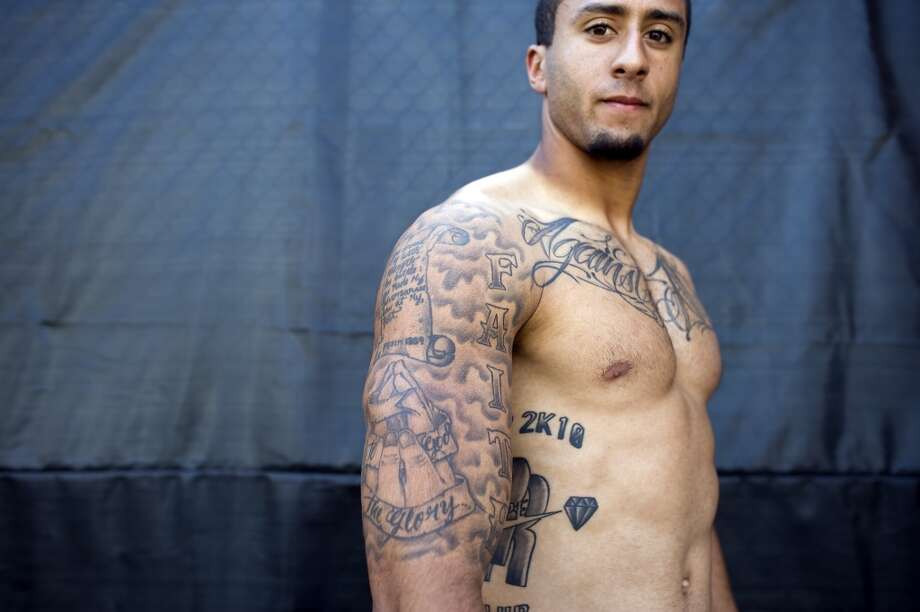 Quarterback Colin Kaepernick shows off his many tattoos at the 49ers practice facility in Sept. 2012. Photo: Michael Short, Special To The Chronicle