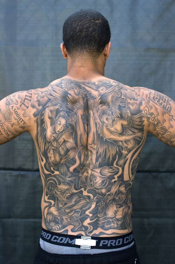 Kaepernick displays his elaborate back tattoos. Photo: Michael Short, Special To The Chronicle