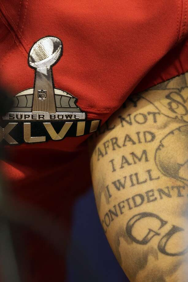 49ers quarterback Colin Kaepernick's tattoo is seen as he answers reporters' questions during media day for Super Bowl XLVII. Photo: Mark Humphrey, Associated Press