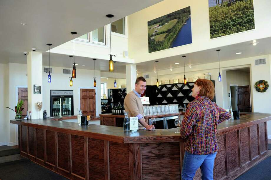 Thirsty Owl Outlet and Wine Garden. 184 S. Broadway, Saratoga Springs.General manager Josh Cupp, center, shares a wine tasting with Eileen Harren at the Thirsty Owl Outlet and Wine Garden in Saratoga Springs, N.Y. (Cindy Schultz / Times Union) Photo: Cindy Schultz / 10021852A