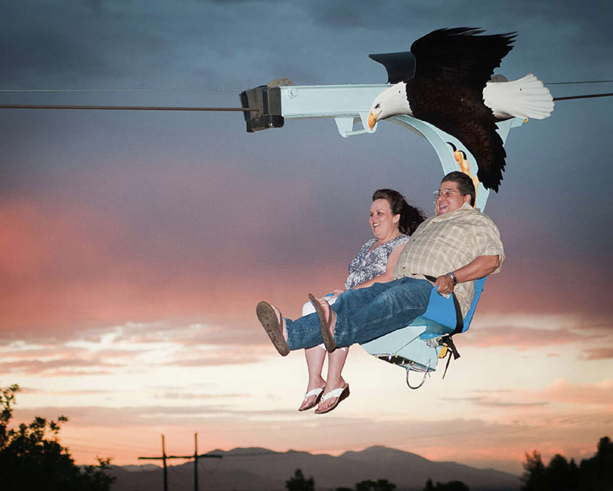 The Iron Eagle, a new zip-line ride, will be opening this fall at the Kemah Boardwalk. The ride will feature side-by-side seating similar to this ride. (photo courtesy of Kemah Boardwalk)