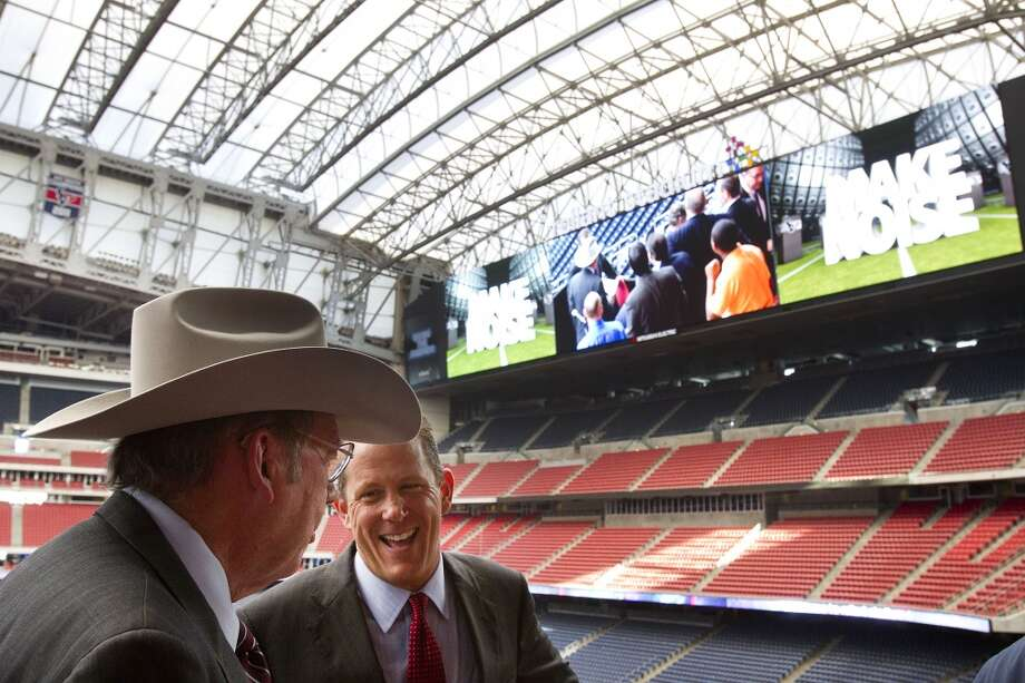 Reliant StadiumLeroy Schafer, COO of the Houston Livestock Show & Rodeo, left, and Jamey Rootes, president of the Texans, share a laugh following the unveiling ceremony for the new HD video boards. Photo: Brett Coomer, Houston Chronicle