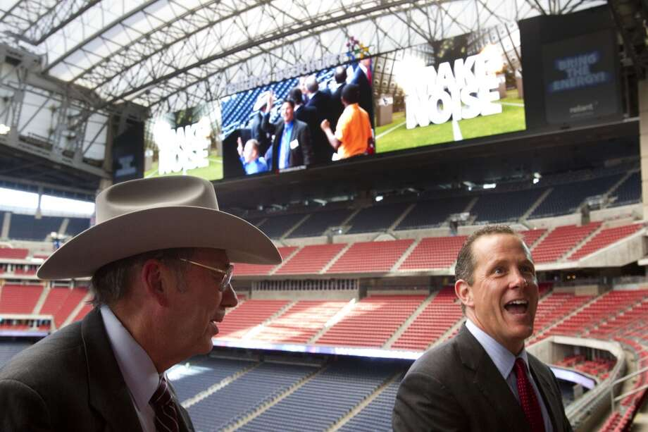 Reliant StadiumLeroy Schafer, COO of the Houston Livestock Show & Rodeo, left, and Jamey Rootes, the president of the Texans, share a laugh following the unveiling ceremony for the new HD video boards. Photo: Brett Coomer, Houston Chronicle