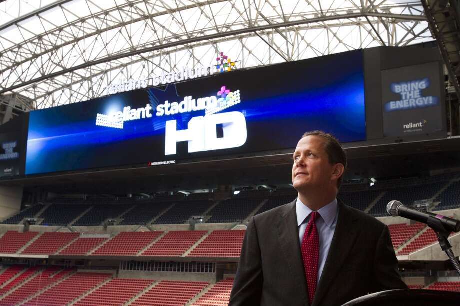 Reliant Stadium  Jamey Rootes, president of the Houston Texans watches as the new HD video boards at Reliant Stadium are turned on Photo: Brett Coomer, Houston Chronicle