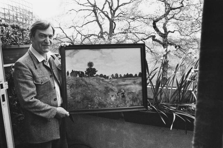 English actor Patrick Troughton was Doctor from 1966 to 1969, and is seen here holding one of his own paintings outside at his home in Teddington, London, 5th May 1981. The work is a copy of Monet's 'Poppy Field'. (Photo by Chris Ware/Keystone Features/Hulton Archive/Getty Images) Photo: Chris Ware, Getty Images / 2012 Getty Images