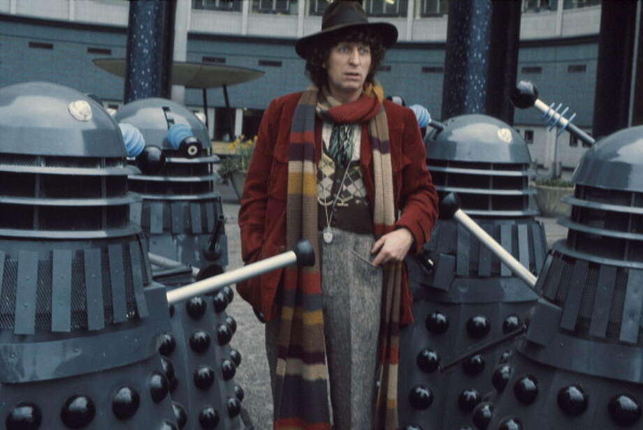 Tom Baker in character as Dr Who (1974 - 1981) with Daleks. Baker was the longest lasting and most eccentric Doctor who was known for his mile-long scarf, floppy hat and comical flair. Photo: Michael Putland / 1974 Michael Putland