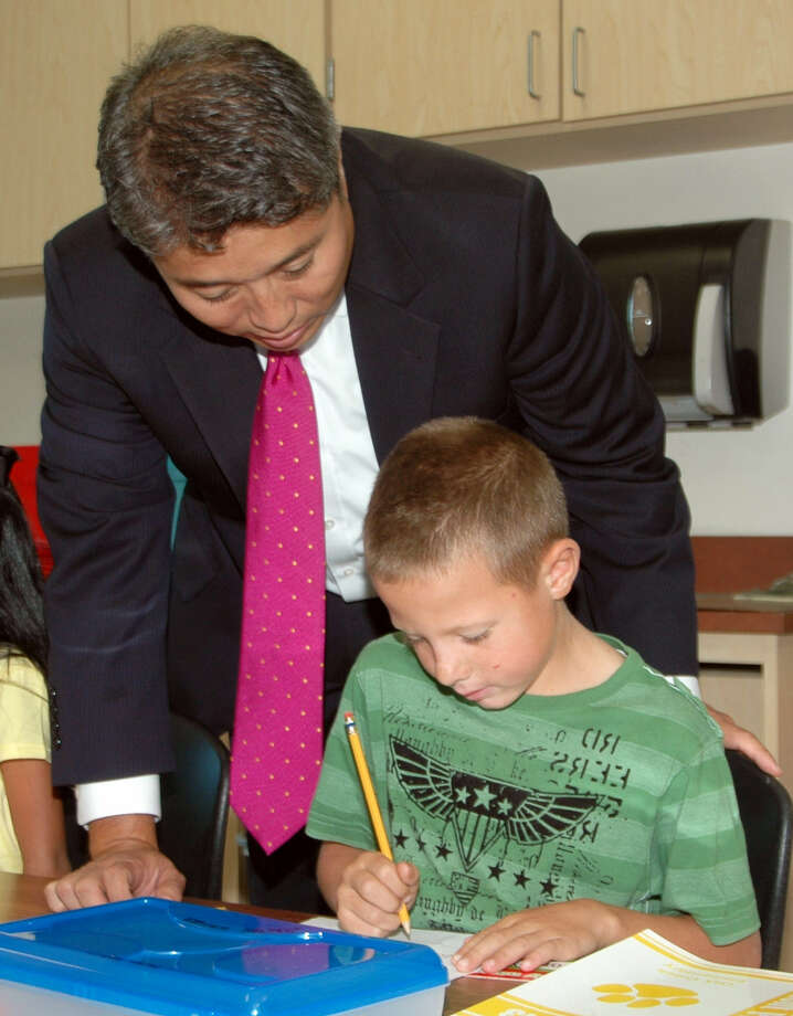 Comal ISD superintendent Andrew Kim talks with Oak Creek Elementary student Dalton Waxler last year. The Comal ISD board recommended raises for district teachers.
