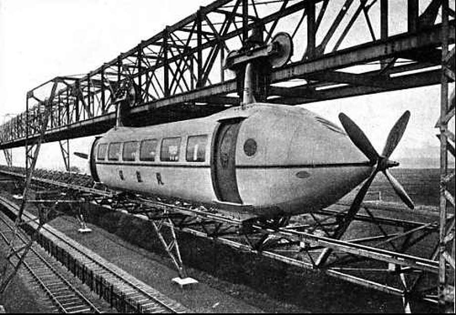 Wikipedia explains: The Bennie Railplane was a form of rail transport invented by George Bennie (1891–1957), which moved along an overhead rail by way of propellers. Despite superficial appearances, it was not a monorail, as it used both an overhead running rail and a guide rail below. It was intended to run above conventional railways, separating faster passenger traffic from slower freight traffic. Photo: Multiple