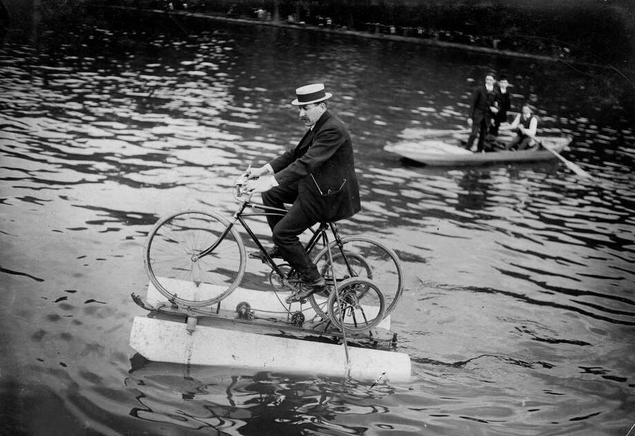 "The ""amphibocycle"", water bicycle, on the river Seine in France, 1909. (Photo by Maurice-Louis Branger/Roger Viollet/Getty Images) Photo: Maurice-Louis Branger, Multiple"