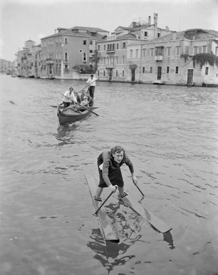 Leda uses a pair of hollow water skis to navigate the canals of Venice, Italy, 1952. She is the daughter of their inventor, a barber named Giovanni Campelli.  (Photo by Archivio Cameraphoto Epoche/Getty Images) Photo: Archivio Cameraphoto Epoche, Multiple / 2012 Archivio Cameraphoto Epoche