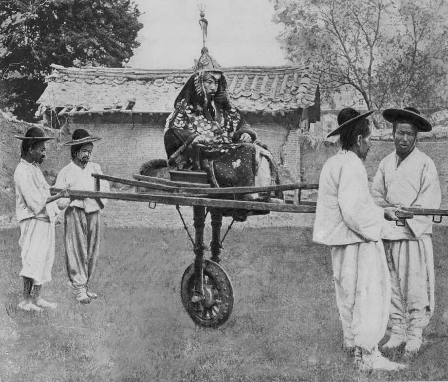 A Korean nobleman on a unicycle supported by four bearers, Korea, circa 1900. (Photo by Paul Popper/Popperfoto/Getty Images) Photo: Paul Popper/Popperfoto, Multiple / 2011 Popperfoto
