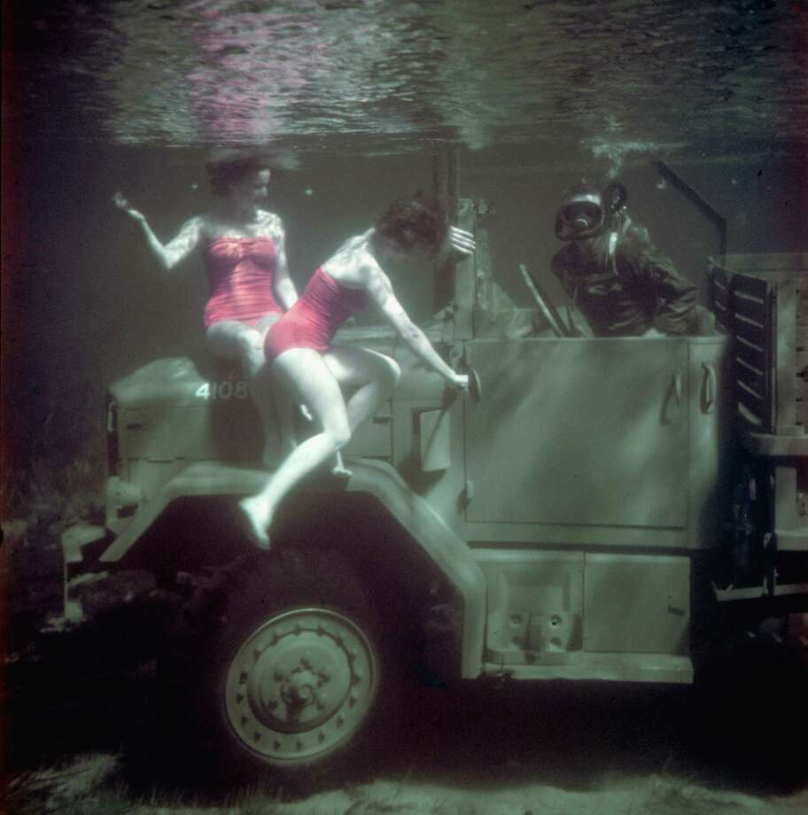 Underwater publicity still shows two women in brightly colored bathing suits as they swim about the REO Motor Car Company's M-34 amphibious cargo truck, built for the US Army, during a demonstration, Rainbow Springs, Florida, 1951. (Photo by Peter Stackpole/Getty Images) Photo: Peter Stackpole, Multiple / Time & Life Pictures