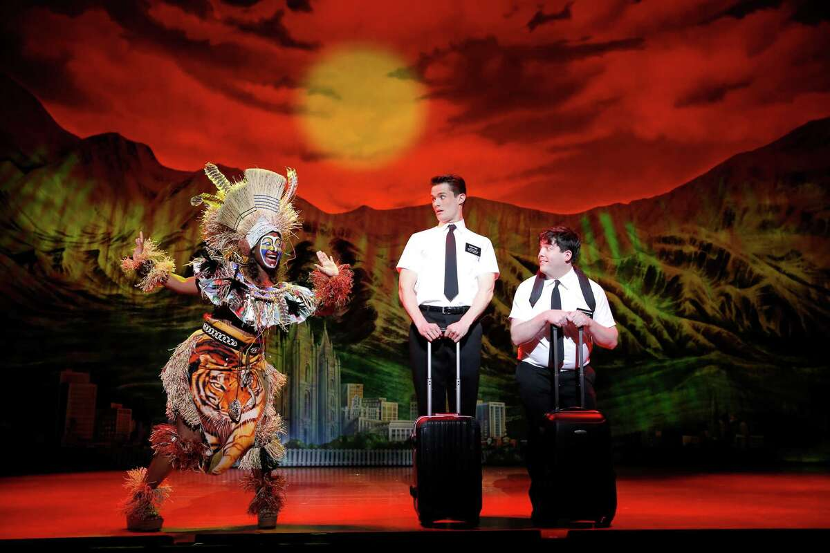 """The Tony-winning """"The Book of Mormon: hits Houston Tuesday at Hobby Center. Depicted in this scene from the national tour are Phyre Hawkins, from left, Mark Evans and Christopher John O'Neill."""