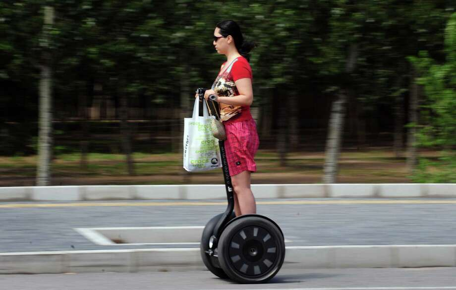 Remember when the Segway personal transporter was going to change transportation as we knew it? (Photo credit should read FREDERIC J. BROWN/AFP/Getty Images) Photo: FREDERIC J. BROWN, Getty Images / 2009 AFP