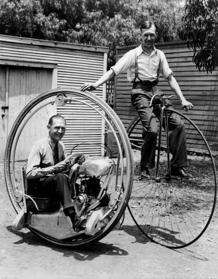 A man on a penny-farthing bicycle alongside Walter Nilsson (left) aboard the Nilsson monowheel, 1935.  (Photo by FPG/Hulton Archive/Getty Images) Photo: FPG, Multiple / 2004 Getty Images