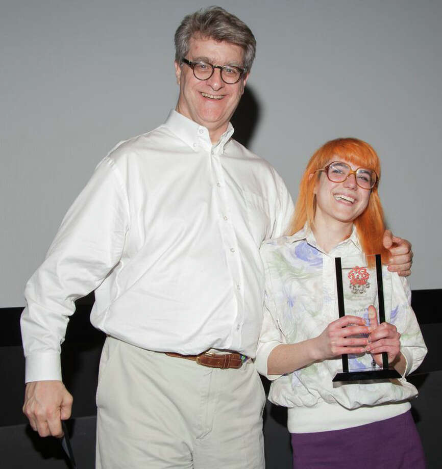 Deanna DeMaglie, who grew up in Danbury, is seen here with renowned animator Fred Seibert, who presented her with a Dusty Award for Outstanding Achievement in Stop Motion Animation for her ìBagelwolfî film. Photo: Contributed Photo