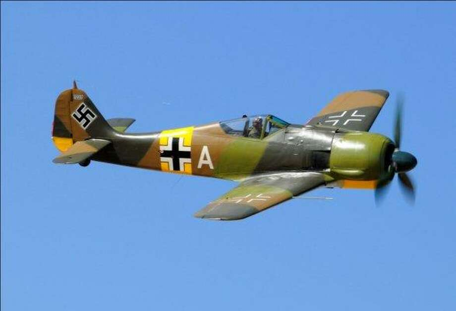 """The Focke-Wulf Fw 190 A-5 (shown above and in the previous slide) """"was  the most advanced radial engine fighter in the world when it entered  combat,"""" according to the Flying Heritage Collection.""""Its appearance in the fall of 1941 was a rude awakening for Allied  designers and pilots. The new German plane was an ideal dogfighter –  fast, light, and small,"""" the collection added. """"It was more than a match  for contemporary versions of the British Spitfire. The Focke-Wulf 190  was also heavily-armed and immensely strong, giving it the ability to  fly in ground attack roles as well."""" Photo: Flying Heritage Collection"""