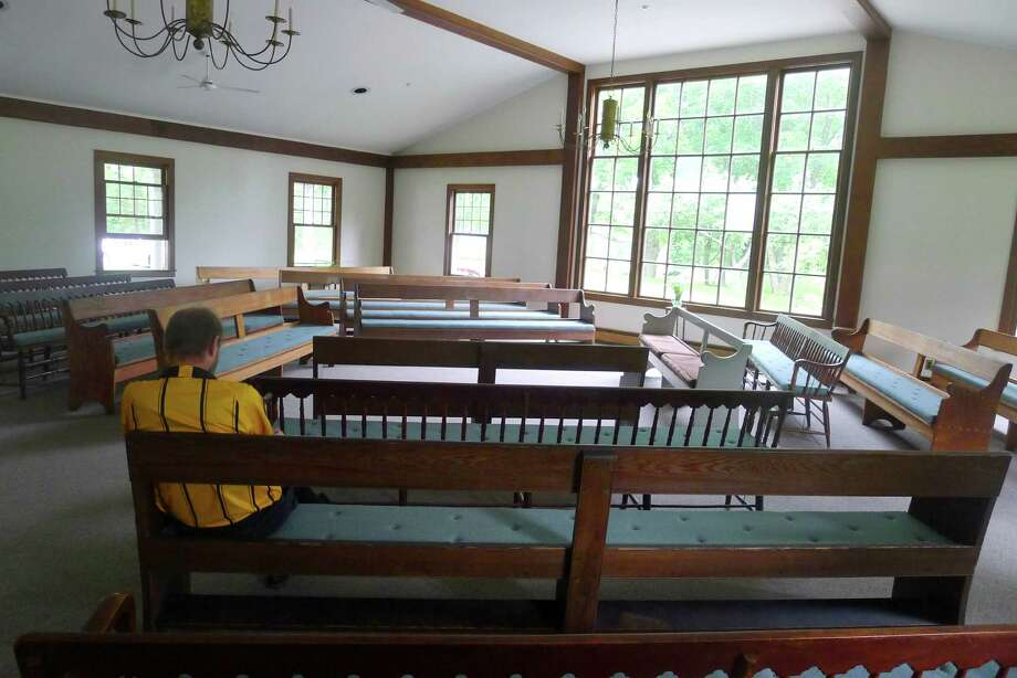 The interior of the Purchase Meeting House, the local Quaker house of worship, is simply furnished with benches where members sit in silence waiting for the spirit to inspire them to speak. This photo was taken by Greenwich Quaker and photographer Bob Baldrige whose marriage was held there. Photo: Contributed Photo