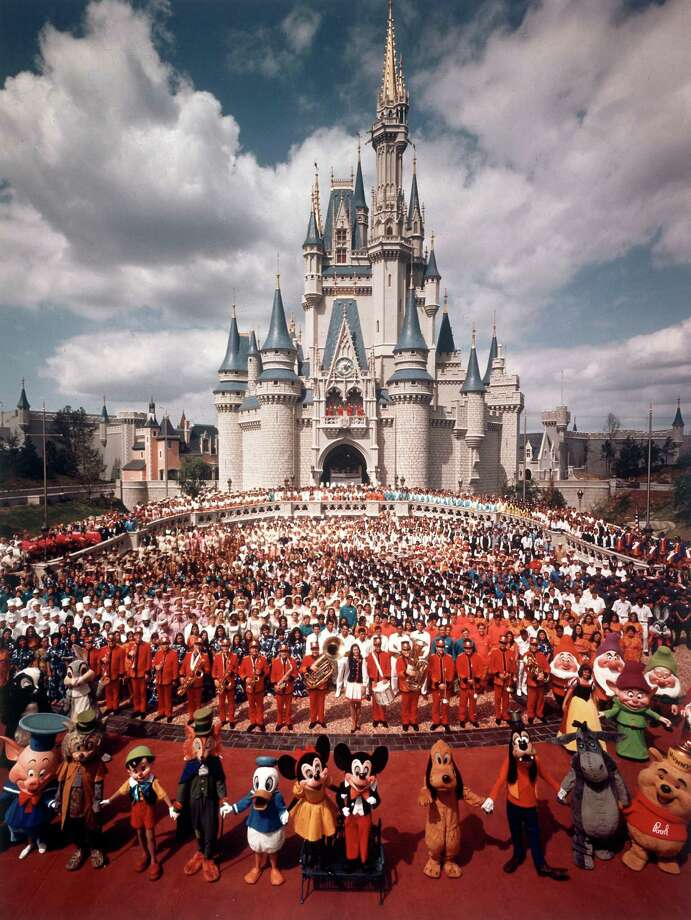 October 1, 1971: Walt Disney World Resort opens with the Magic Kingdom in Orlando, Florida. (thewaltdisneycompany.com) Above: Walt Disney characters and park staff pose en masse in front of Cinderella's Castle just prior to the grand opening of Walt Disney World. Photo: Yale Joel., Time & Life Pictures/Getty Image / Time & Life Pictures