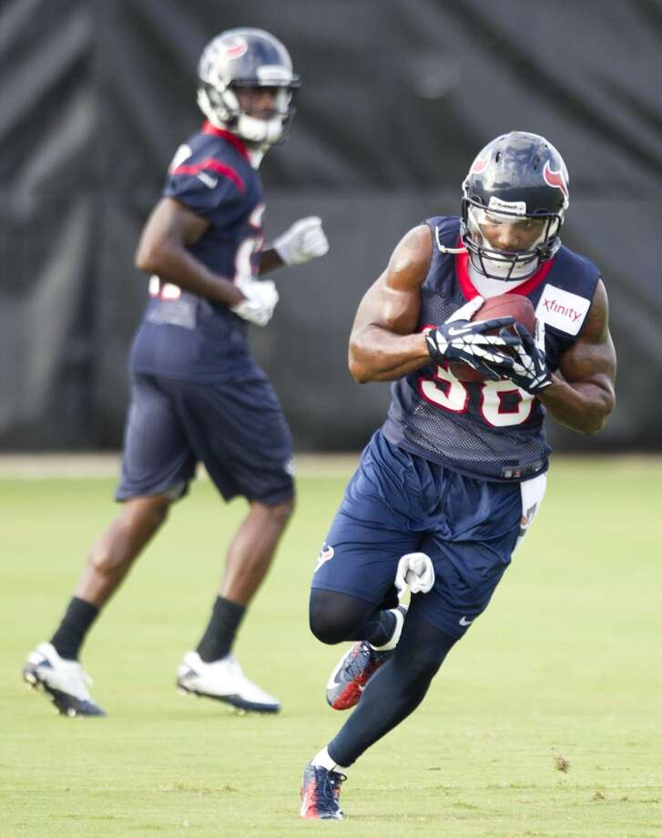 Free safety Danieal Manning (38) returns a ball during a turnover drill. Photo: Brett Coomer, Chronicle