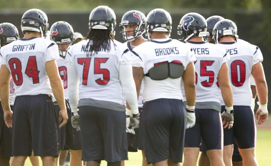 Quarterback Matt Schaub, center, huddles up with the Texans offense. Photo: Brett Coomer, Chronicle