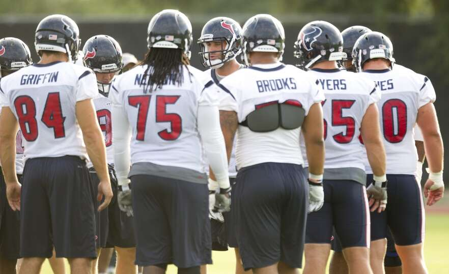 Quarterback Matt Schaub, center, huddles up with the Texans offense.