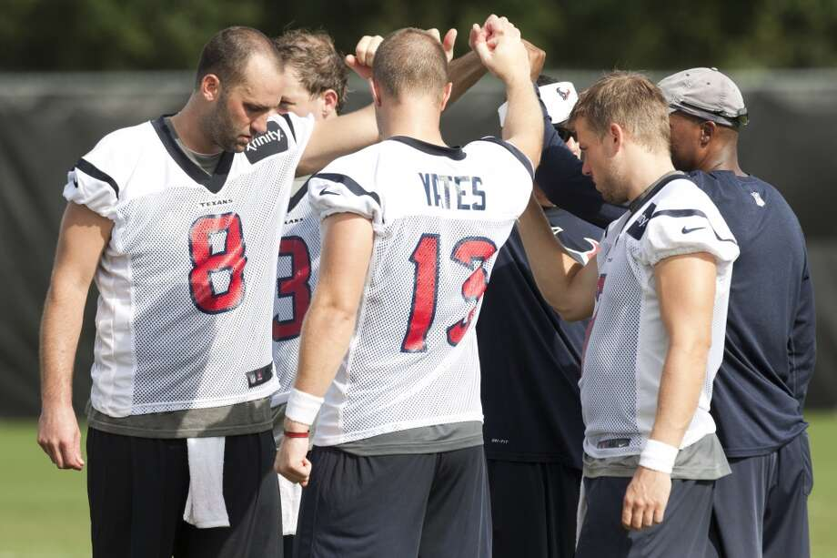 Texans quarterbacks huddle up at the end of practice. Photo: Brett Coomer, Chronicle