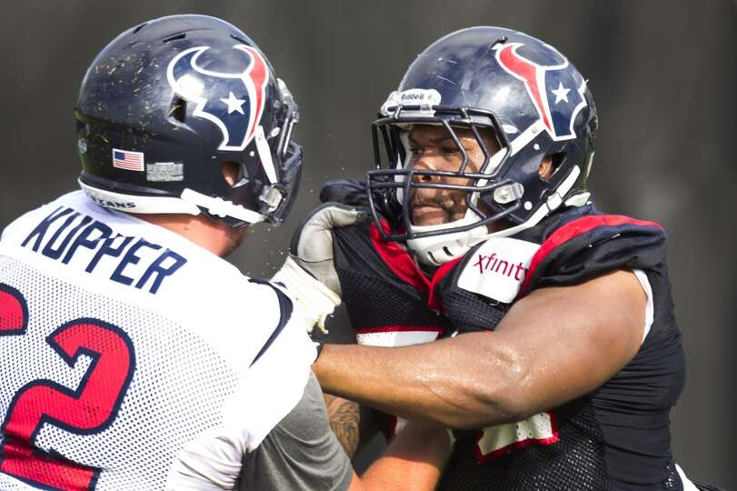 Texans guard Alex Kupper (62) blocks nose tackle David Hunter (72).
