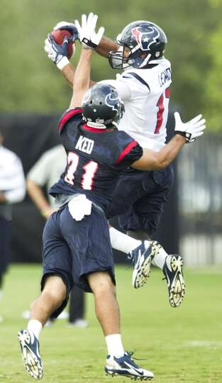 Wide receiver Alec Lemon (17) jumps to make a catch with defensive back Shiloh Keo (31) defending.