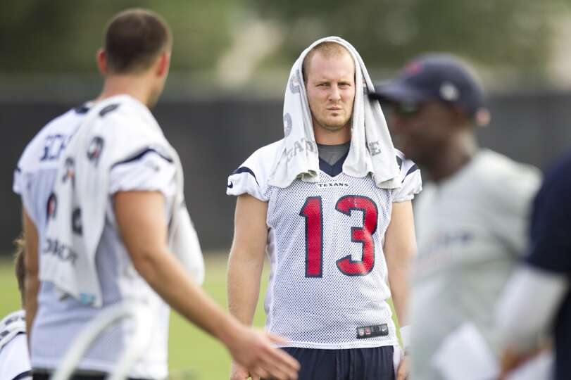 Quarterback T.J. Yates (13) takes a break between drills.