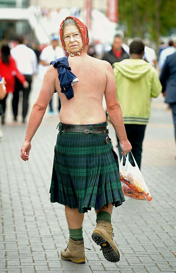 Queen for a day:We doubt this kilted soccer fan will portray Her Majesty in a favorable light during the Scotland-England match at London's Wembley Stadium. Photo: Dominic Lipinski, Associated Press