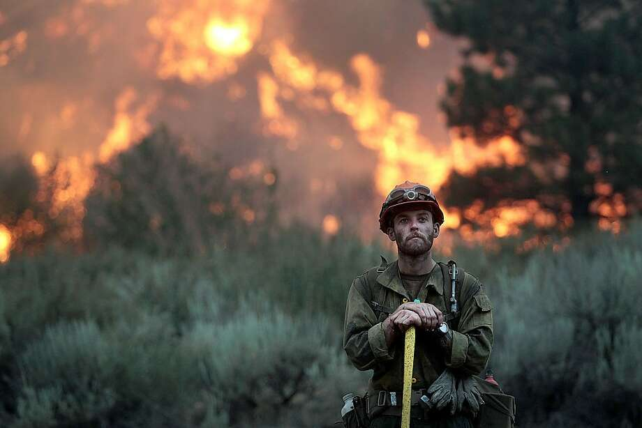 Portrait of a Hotshot:A member of the Idaho City Hotshots takes a break to pose for a photo after creating a back burn along the Pine-Featherville Road near Pine, Idaho. Firefighters were battling the Elk Fire Complex, which has burned more than 90,000 acres. Photo: Ashley Smith, Associated Press