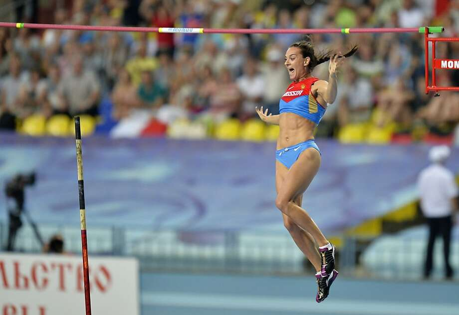 Aces the bar exam:Russia's Yelena Isinbayeva springs to a gold medal in the pole vault   at the World Athletics Championships in Moscow. Photo: Martin Meissner, Associated Press