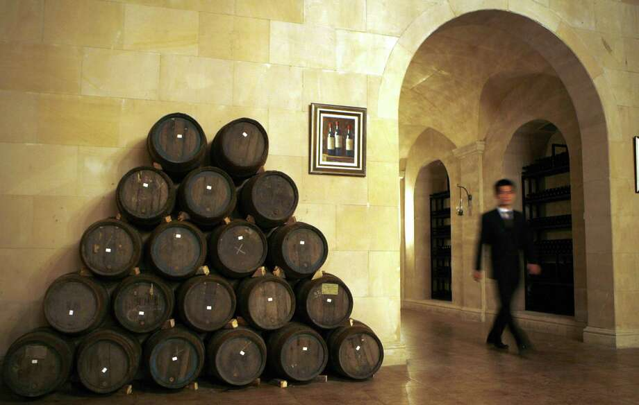Zhang Yucheng was inspired by his love of French wine. His private wine  cellar stocked with 2,000 bottles of France's finest wines, along with a bunch of barrels, apparently. Photo: PETER PARKS, AFP/Getty Images / 2006 AFP