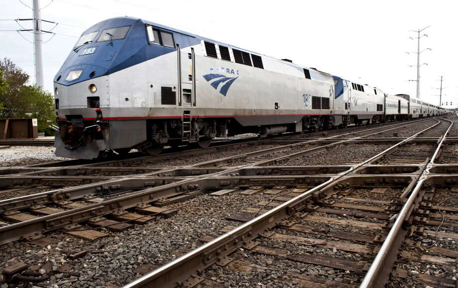 An Amtrak train passes through Chicago's south side, on May 2, 2012. Federal, state, local and industry officials are completing the early stages of a project to untangle Chicago's rail system, which currently delays cross-country freight loads. Photo: NATHAN WEBER / NYTNS