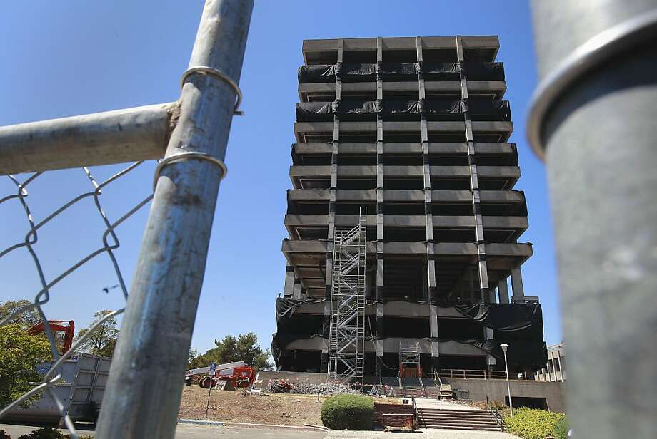 The Warren Hall building, on Tuesday August 13, 2013, is prepared for an implosion in Hayward, Calif. Plans are underway for an implosion to level the twelve story tall Warren Hall building on the Cal State University East Bay campus. Photo: Michael Macor, San Francisco Chronicle