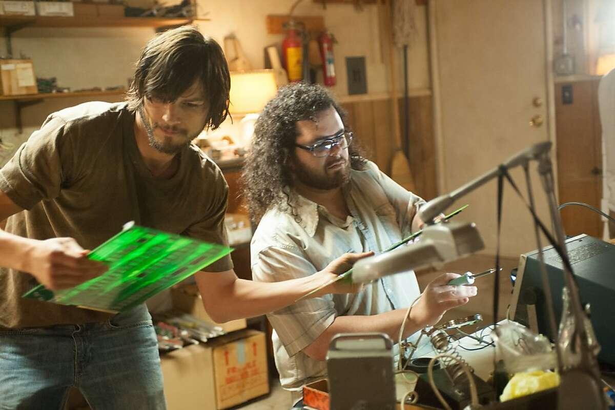 Ashton Kutcher and Josh Gad star as Steve Jobs and Steve Wozniak in JOBS opening in 2013.