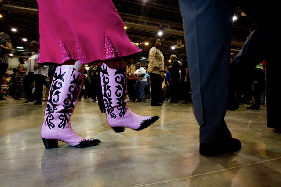 Like these pink cowboy boots. Flats or cowboy boots both work for dances ike the two-step. Show off your style with a pair that is comfortable and snazzy.  Photo: Johnny Hanson, Houston Chronicle / © 2011 Houston Chronicle
