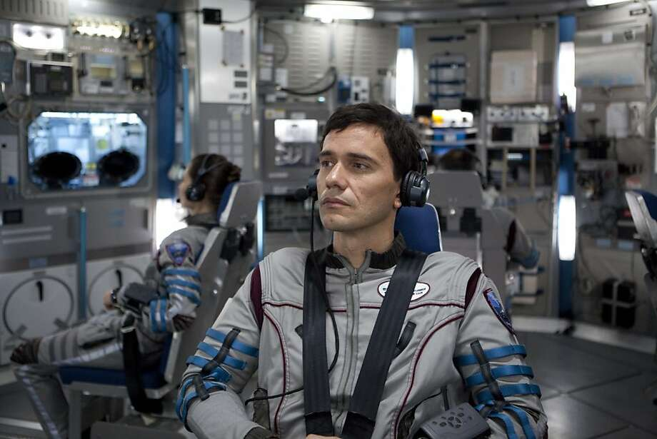 Karolina Wydra and Christian Camargo are two of six astronauts on a voyage to one of Jupiter's moons to confirm there's liquid water below the icy surface. Photo: Magnet Releasing