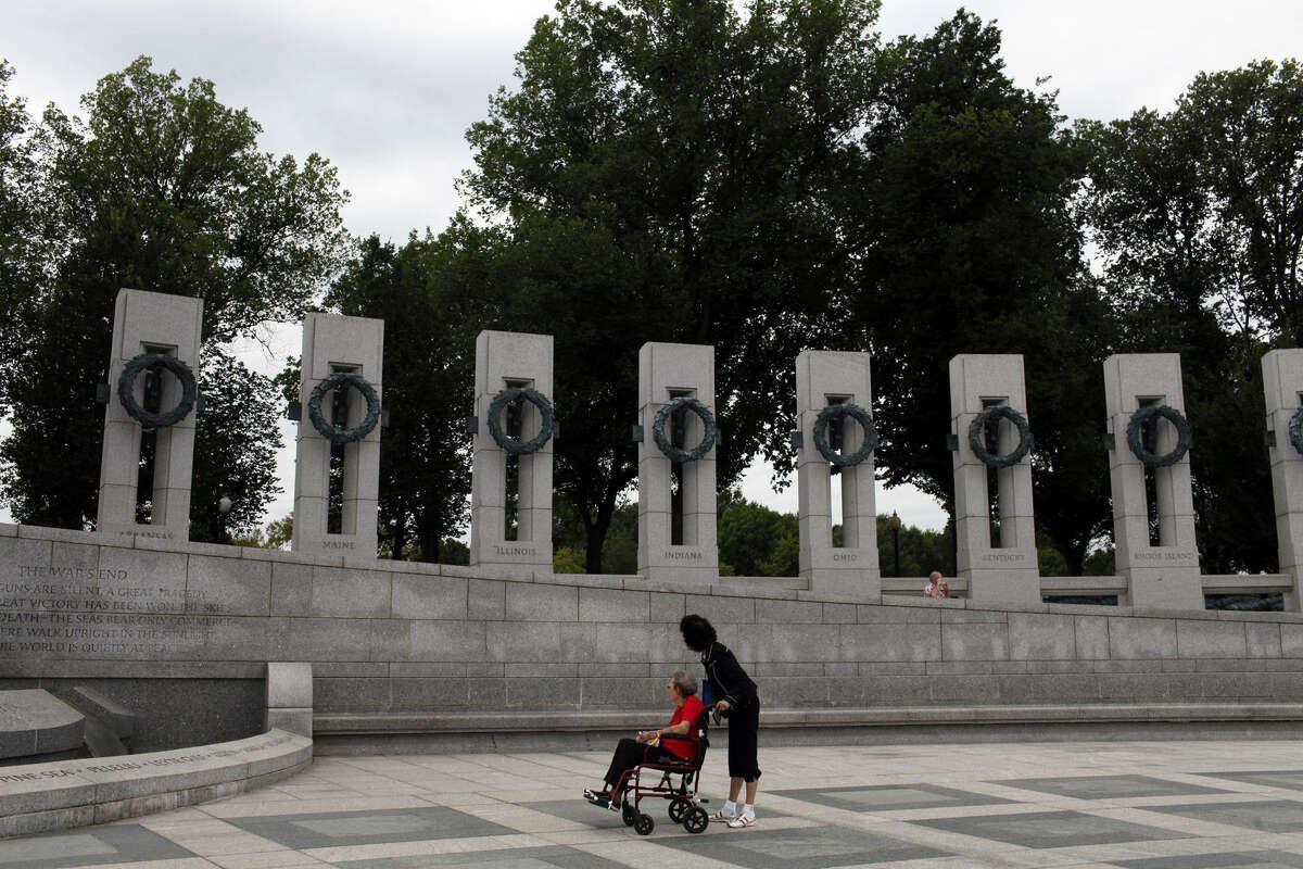 A nurse shows a World War II veteran around the National World War II Memorial as part of the Honor Flights program. The last Alamo Honor Flight from San Antonio to Washington leaves this week.