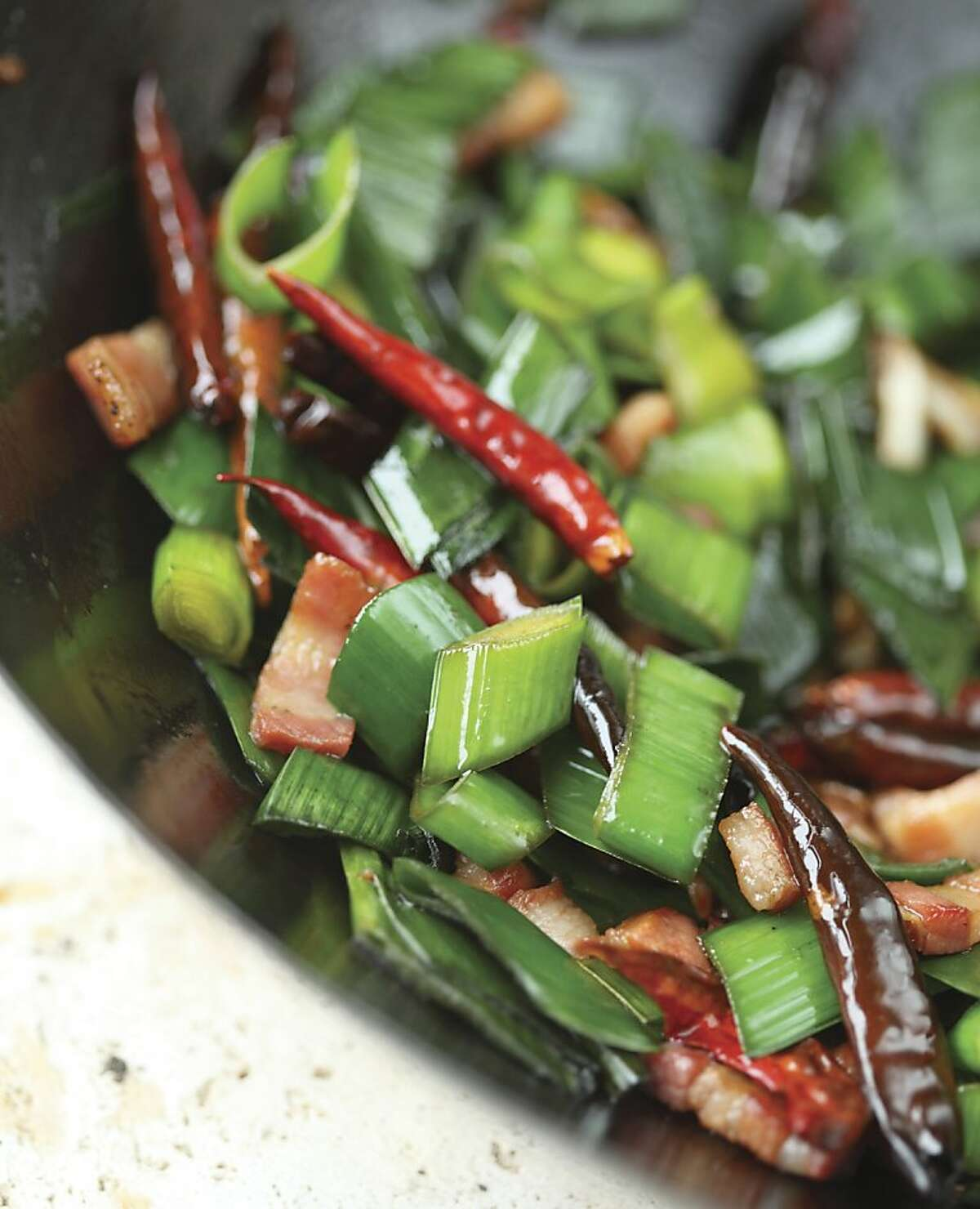 "Leek Greens Stir-Fry from the book, ?'Root to Stalk Cooking,?"" by Tara Duggan from Ten Speed Press."