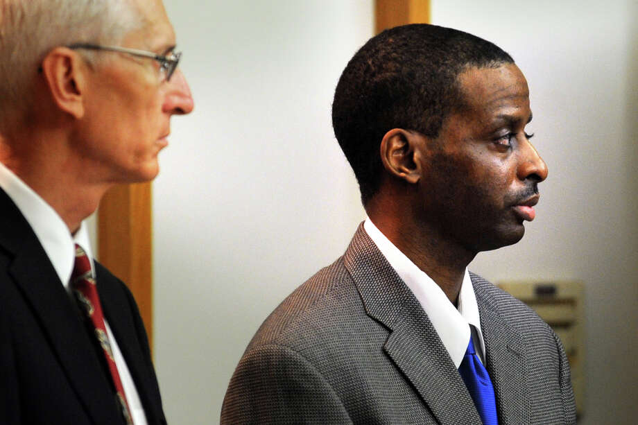 "Russell Peeler Jr. stands with his defense lawyer, Robert Sullivan, on the first day of jury deliberation during his murder trial in Bridgeport Superior Court, in Bridgeport, Conn., Aug. 14th, 2013. Peeler is on trial for the 1998 shooting death of Rudolph Snead Jr., and has already been convicted and sentenced to death for ordering the murder of Karen Clarke and her eight-year-old son, Leroy ""B.J."" Brown Jr. in their Bridgeport, Conn. home in 1999. Photo: Ned Gerard / Connecticut Post"
