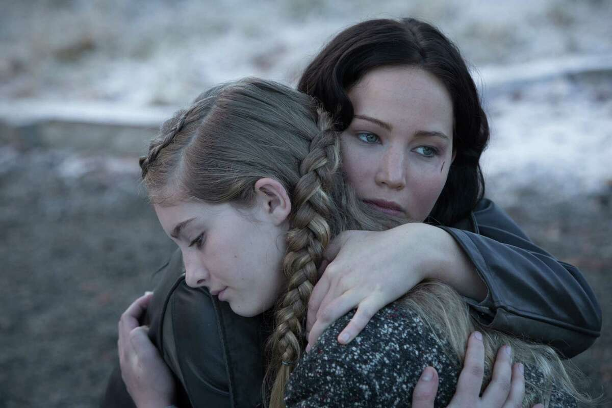 Jennifer Lawrence and Willow Shields pause for emotional sustenance in 'The Hunger Games: Catching Fire' Nov 22