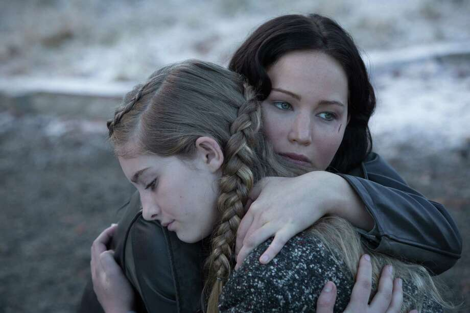 "Jennifer Lawrence and Willow Shields pause for emotional sustenance in ""Hunger Games."" Photo: Courtesy Murray Close"
