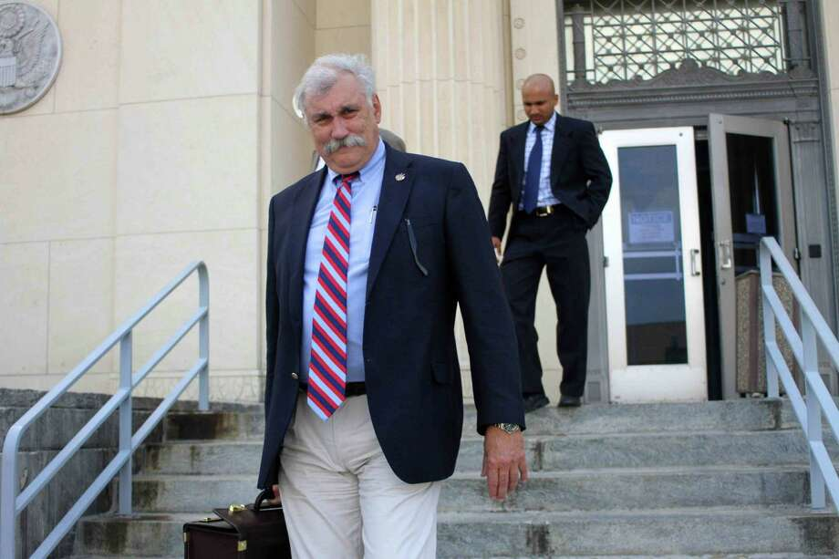 In this July 9, 2011 photo, U.S Attorney John Craft leaves the federal court building in Beaumont, Texas. On Wednesday, Aug. 14, 2013, officials said derogatory comments Craft made about President Barack Obama and Trayvon Martin on Facebook are being reviewed. (AP Photo/The Courier, Jason Fochtman) Photo: Jason Fochtman, MBR / Conroe Courier