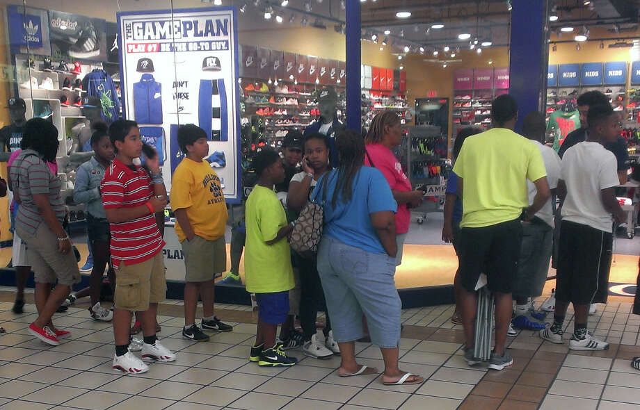 Fans of Michael Jordan's new shoe lined up outside the store to get ticket good for the purchase of a pair when they're released on Saturday. Photo: Jose D. Enriquez III