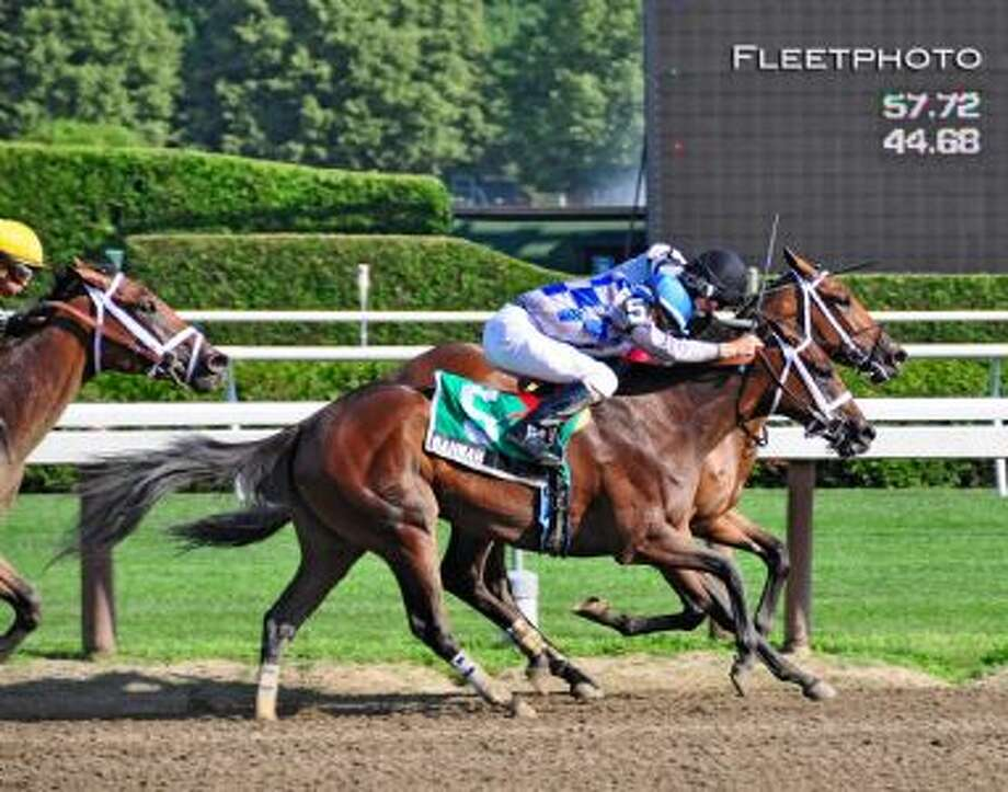 Bahnah and Brazen Persausion went all out to the finish line to settle for a dead heat. (George Zilberman)