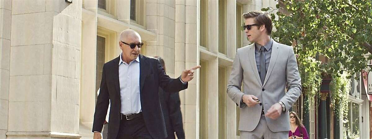 """Harrison Ford and Liam Hemsworth in, """"Paranoia."""""""