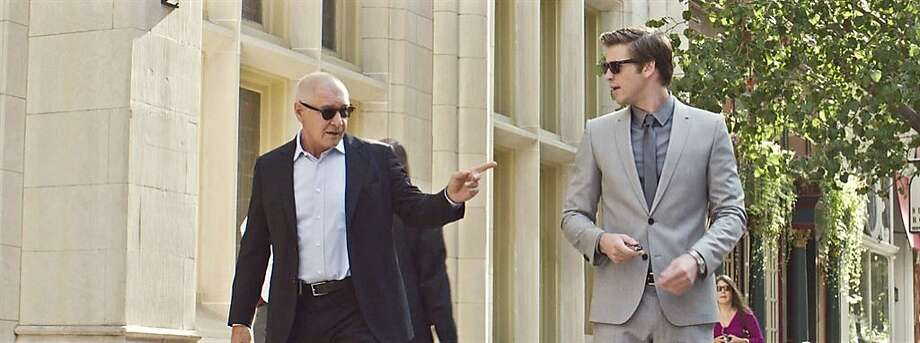 "Harrison Ford collects a paycheck and Liam Hemsworth models a superb wardrobe in ""Paranoia."" Photo: Relativity Media"