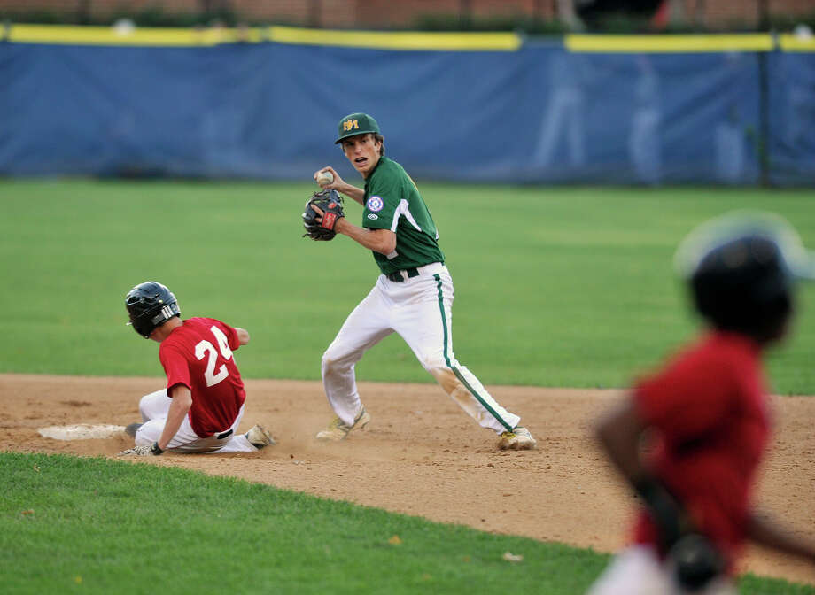 "New Milford Express shortstop Jackson Olson forces out Diamond Buddies Rams' Matt Kolenda at second before throwing to first during their 15-year-old John ""Sharkey"" Laureno Memorial tournament playoff game at Cubeta Stadium in Scalzi Park in Stamford, Conn., on Wednesday, Aug. 14, 2013. The Diamond Buddies Rams of Pelham, N.Y., beat the New Milford Express, 6-2. Photo: Jason Rearick / Stamford Advocate"